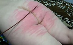 spanking her fat Slut ass to deep redness